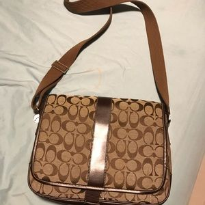 Tan Crossbody authentic coach bag barely used .